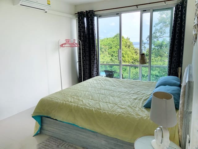 Quadruple Suite-size beds with king-size bed and ocean views. Your Home Samui