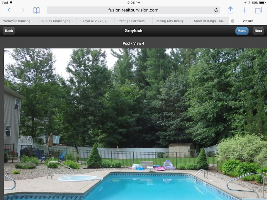 Inground and overflow pool. Diving board.