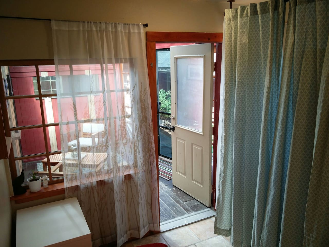 View from the bedroom toward private enclosed patio sitting area.