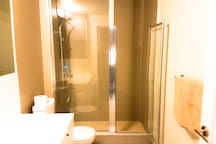 Washroom with a Glass Stand-in Shower