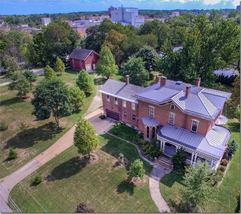 This picturesque landmark historic home, located in the heart of Elyria's historic district, is a 5 minute walk to the Downtown Elyria's Commons, featuring restaurants, shops, Elyria Public Library, Elywood Park, Historical Society, the East and West Black River Waterfalls, Cascade Park, and many other quaint attractions.