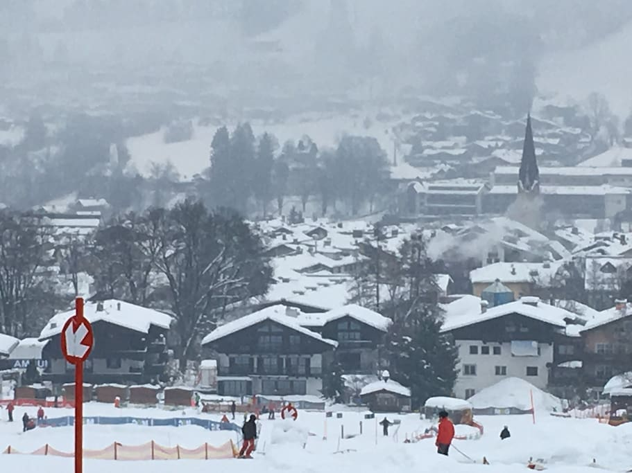Picture of Kitzbühel taken from exact location of where the Apartment / House is located. Allows you to ski down directly from the property right to the Hahnenkamm lift and right back into the property when reaching the end of Hahnenkamm piste also used by the Rote Teufel Ski School to train kids and mostly beginners. Located right in front of Apartment / House