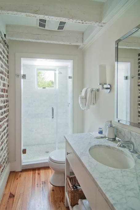 Gorgous bath with marble counter & shower
