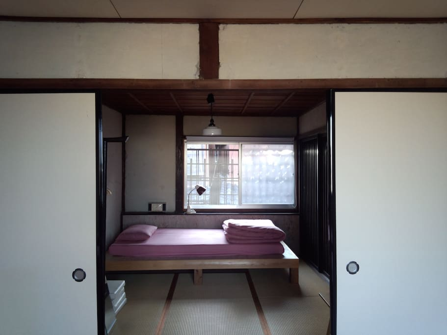 This is another bed room. Actuary this is a not bed. It set futon on the platform. If stay at this house for four persons also set futon on the Tatami.