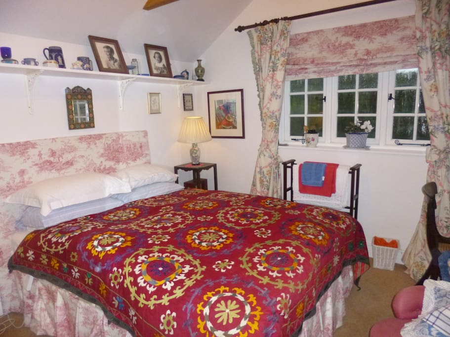 One of three guest rooms, this one with en suite bathroom and quiet and lovely views down the garden to the River Alham..