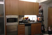 Kitchen with microwave, refrigerator, electric stove, toaster & sink