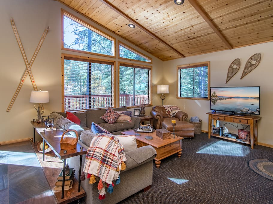 Soaring ceilings, stylish alpine decor, and an abundance of natural light fill the home with warmth.