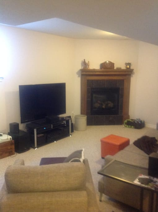 Bright, spacious sitting room with big screen TV with sound surround