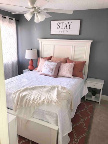 Cozy second bedroom includes queen sized bedding with eucalyptus sheets and pillows. Private television with generous viewing options available right here in your own cozy setting~