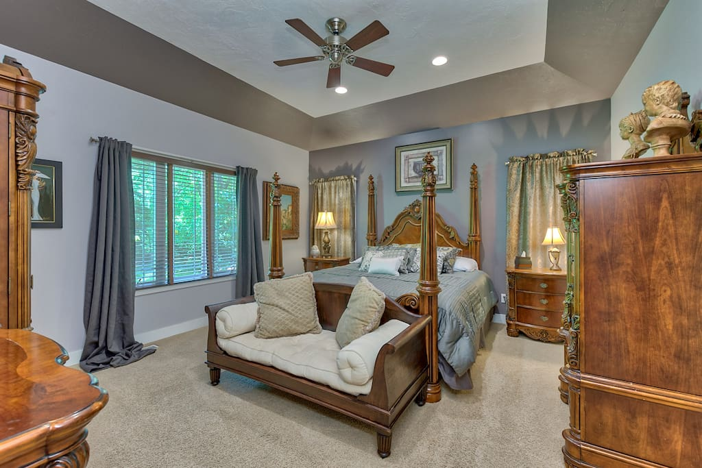 "Beautifully decorated main floor master with a very comfortable king size bed, 40"" LED HDTV, and ample storage"