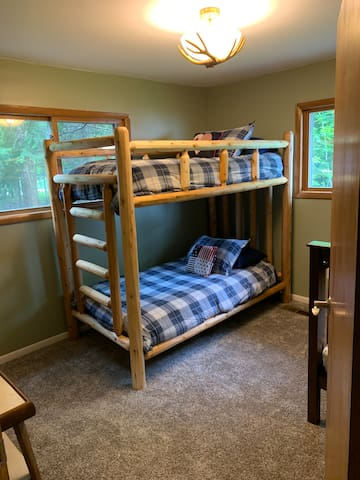 Twin bunk bedroom 3 has a new log bed frame, bedding and pillows. Bedroom has an accessible closet