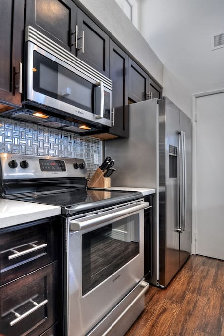 New Kitchen with beautiful tile and Botch appliances.