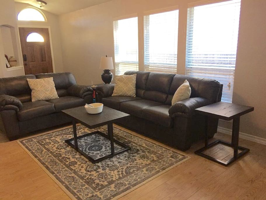 """""""Bright and comfy!""""  Living room - has SMART TV with satellite, DVR, apps."""