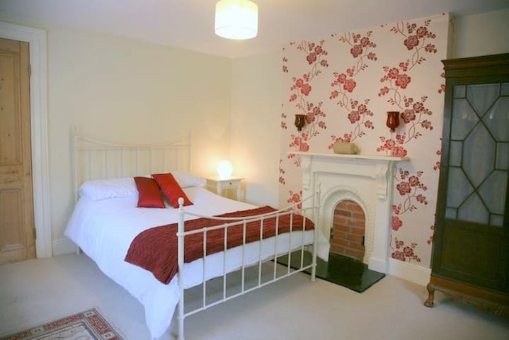 Red bedroom with double bed