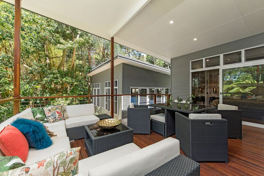 Relax on the outdoor lounge or eat at the outdoor dining table amongst the trees