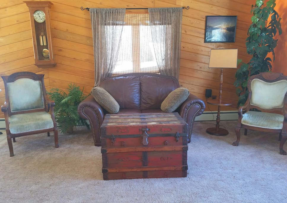 Sunny living room with rustic chest. (Open the chest to find games!)