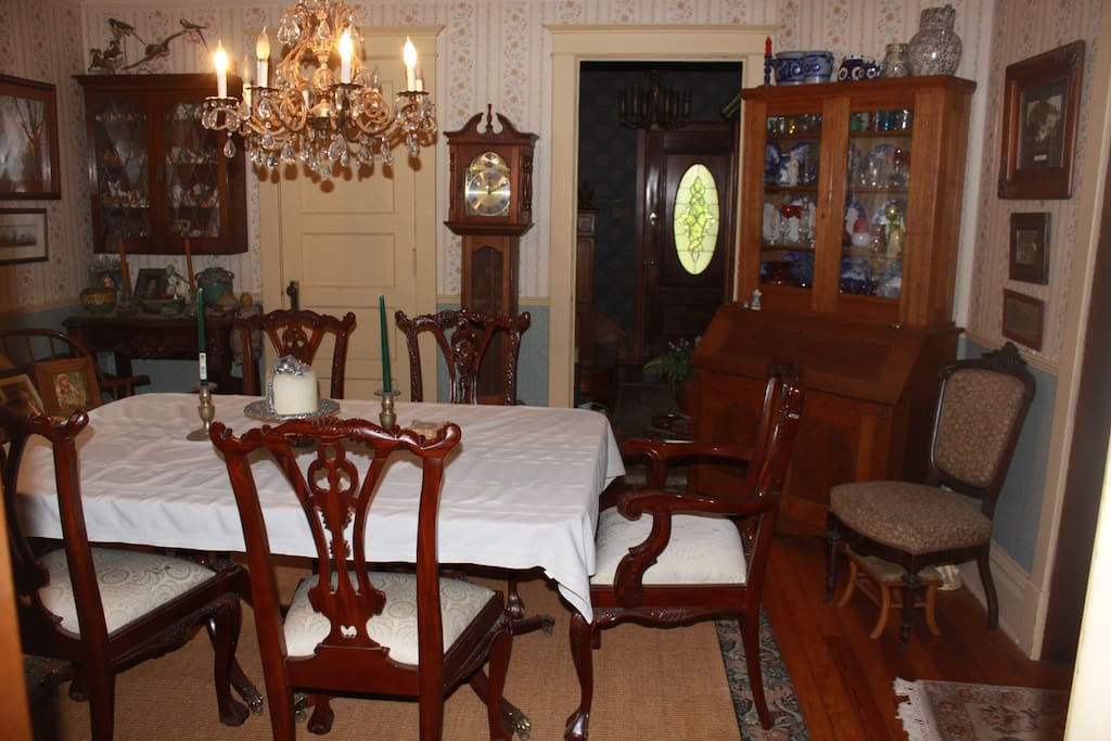 Formal dining room has plenty of room for a game of cards or a six-course meal! looking to entry hall