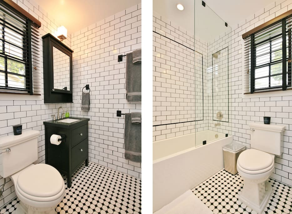 Fully tiled, Old Hollywood style bathroom with all new amenities.