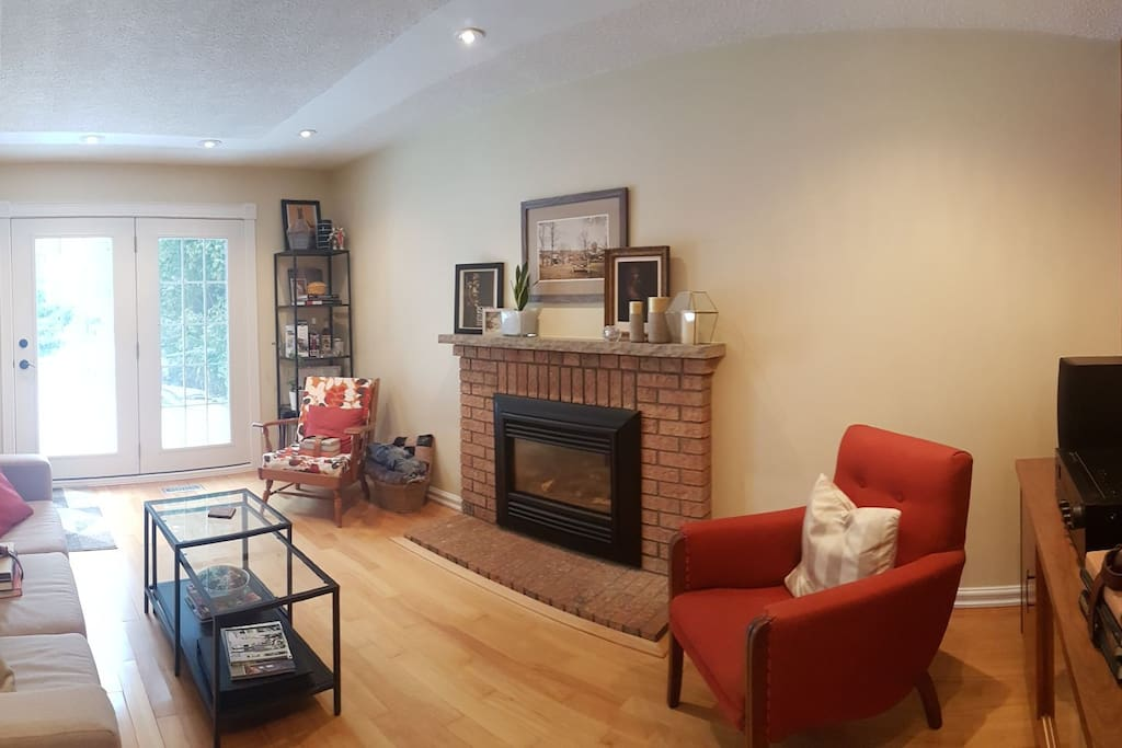 Living room with gas fireplace, record player and entrance to back yard