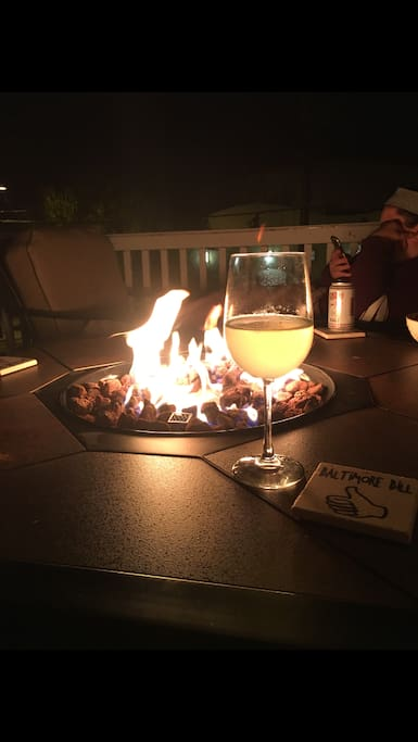 wine by the fire pit on deck