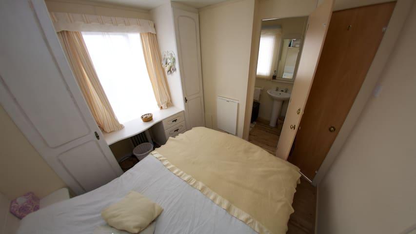 Double bedroom with door to bathroom