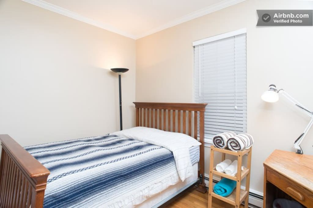 your cozy Airbnb room (full size bed, towels, desk and stool, web enabled HDTV, iron and board)