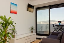 LIVING ROOM DAY VIEW TOWARDS THE SAGRADA FAMILIA & WITH DOUBLE SOFA BED 140x200cm