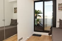 ROOM WITH 1 bed of 135 x 190 cm (in this picture the previous one)-VIEW TOWARDS THE TERRACE/TIBIDABO-SAGRADA FAMILIA VIEW