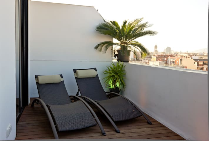 SUNBEDS ON THE PRIVATE 20m2SOLARIUM/TERRACE WITH INDEPENDENT ACCESS FROM THE ROOM AND THE LIVING ROOM