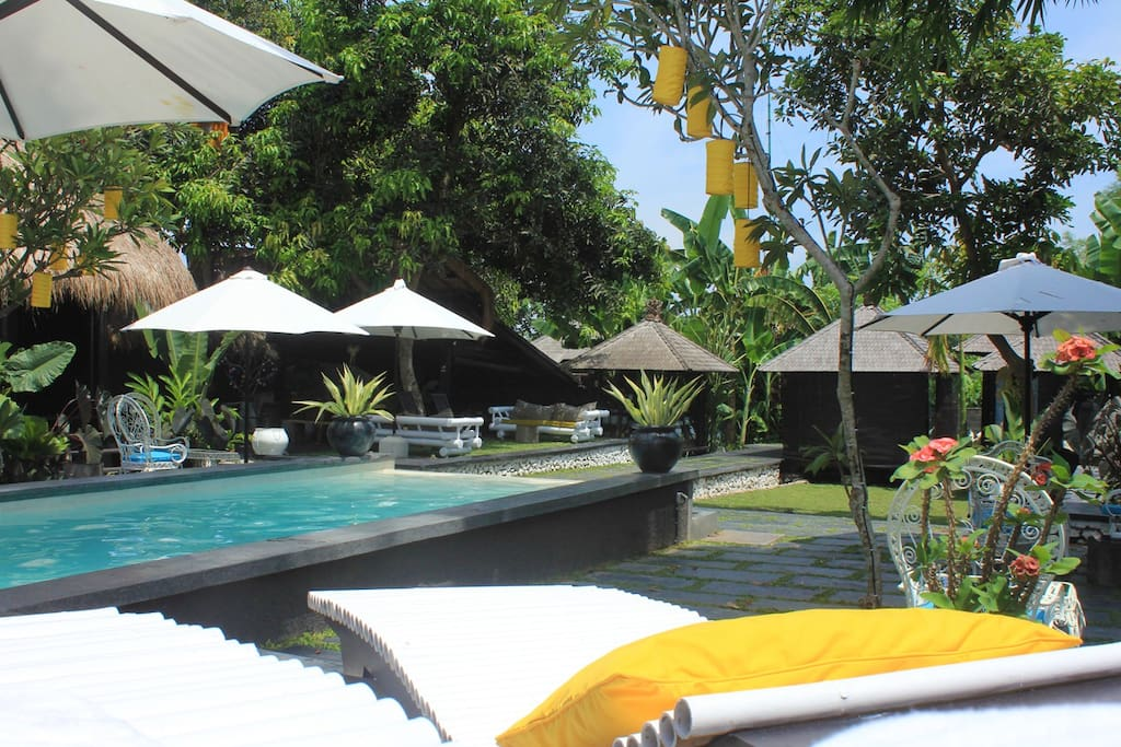 Relax on the sun loungers around the pool.