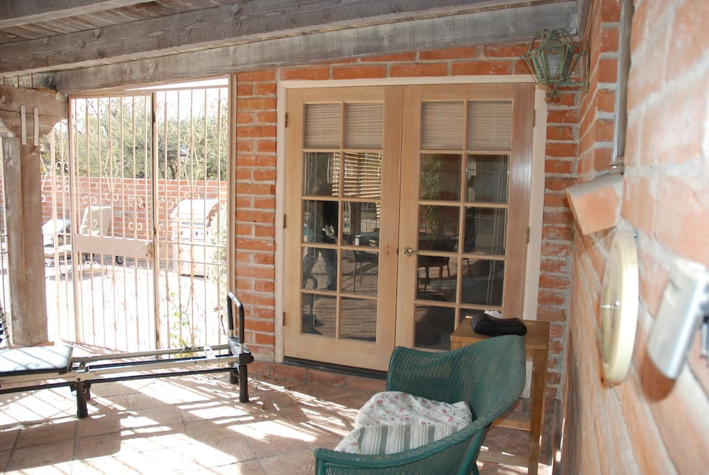 French Doors from Guest BR to covered porch, exposed wood beam ceilings