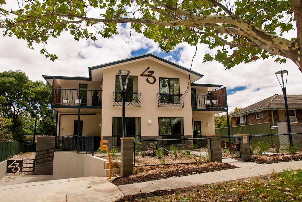 Front of the apartments. Located on a shady, suburban street in Dickson, Canberra.