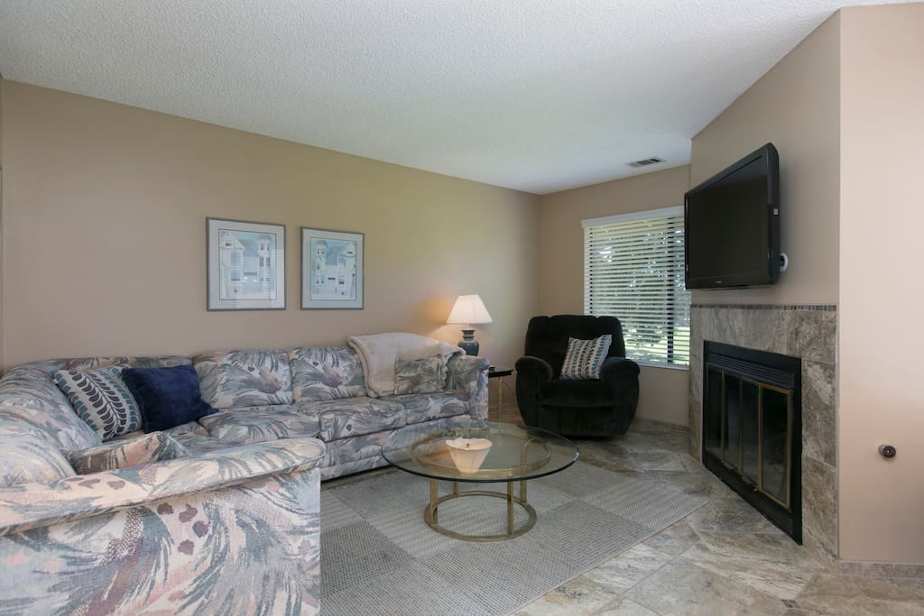 """46"""" flat-screen, gas fireplace, and sectional sofa for 6 in the living area"""