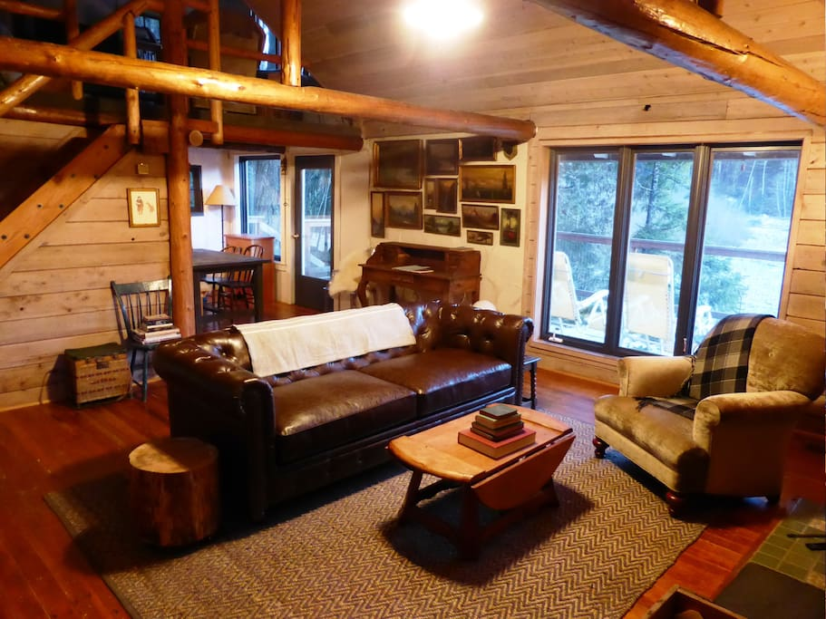 The main cabin features the living room, dining area, kitchen, and loft.