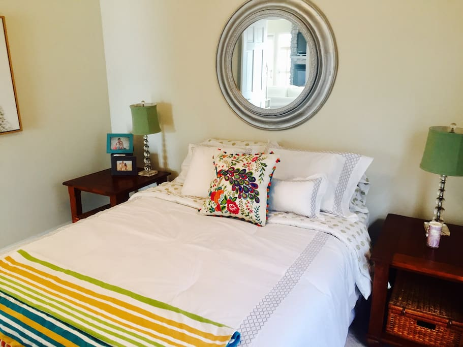 Waterfront bedroom with queen sized bed, comfy bedding and lovely decor.