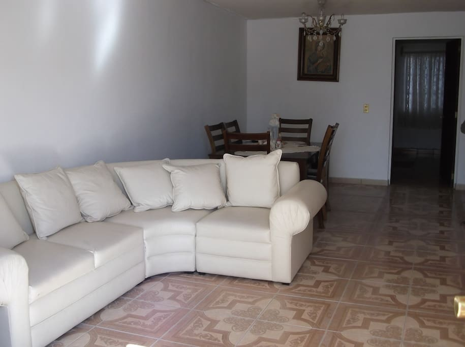 New furniture and tile floors in light-filled family room on first floor