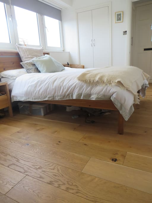 Separate bedroom with chest of drawers, fitted wardrobes and bedside table.