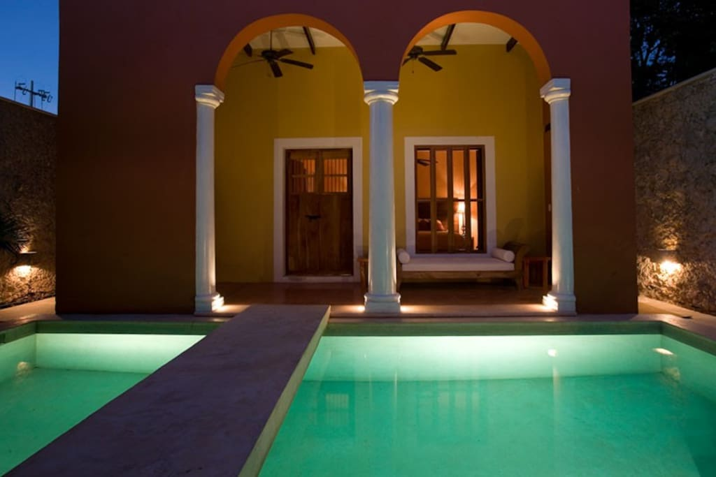Nightime view of bridge over pool to downstairs Master bedroom.