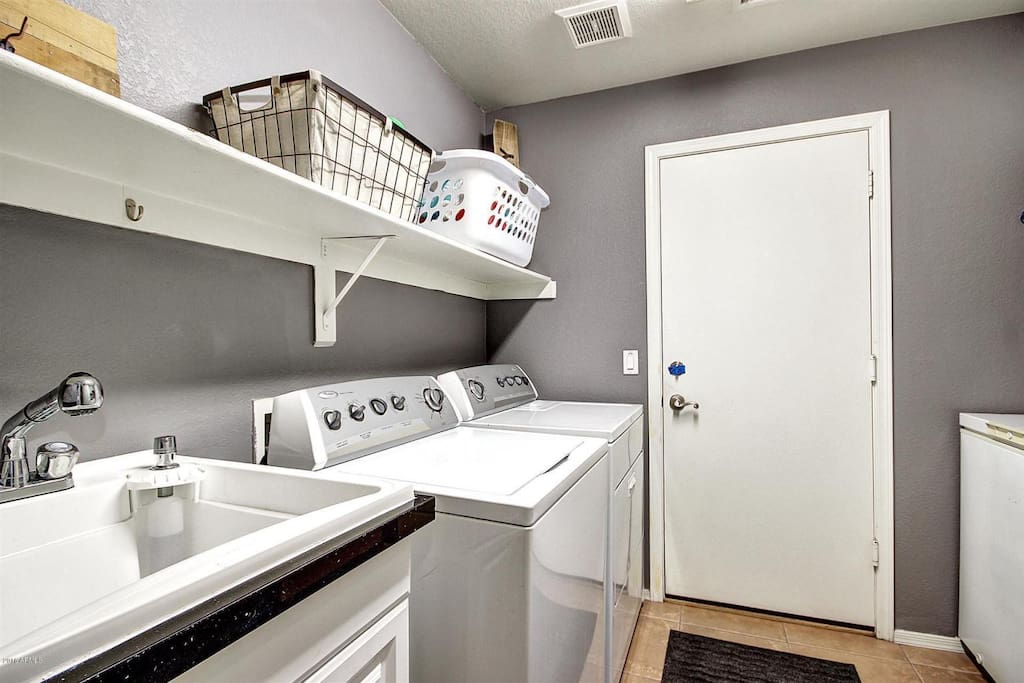 Washer/ Dryer and Sink in the Laundry Room