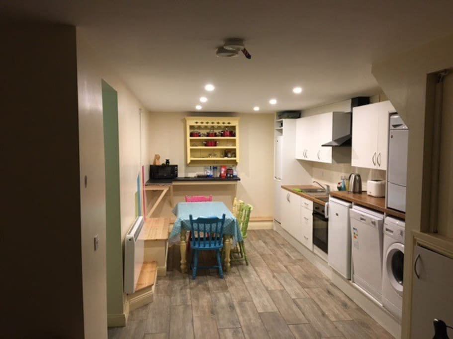 This is our spacious kitchen full equipped with washer, dryer hob & over.
