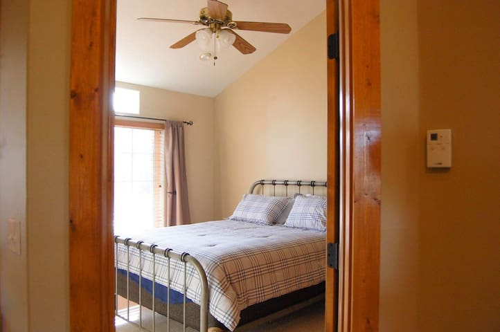 Master bedroom with ceiling fan. Large master closet with plenty of storage.