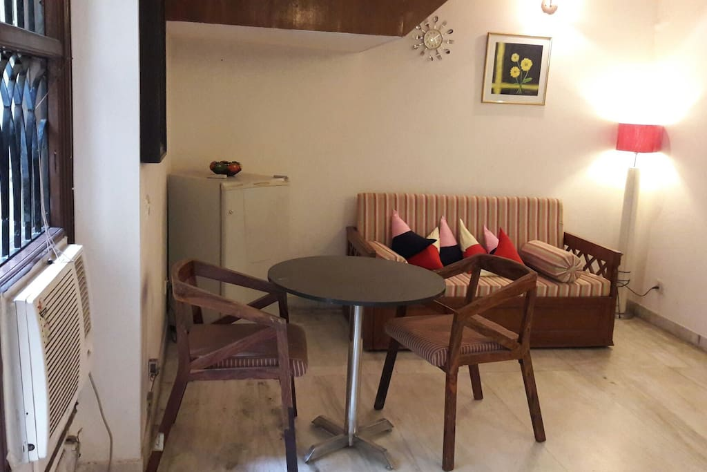 furnished apartment with moveable dining table and antique box double sofa-bed.