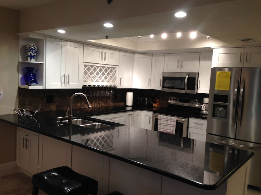 Fully Stocked Granite Kitchen with Stainless Steel Appliances and everything you can need for your beach vacation