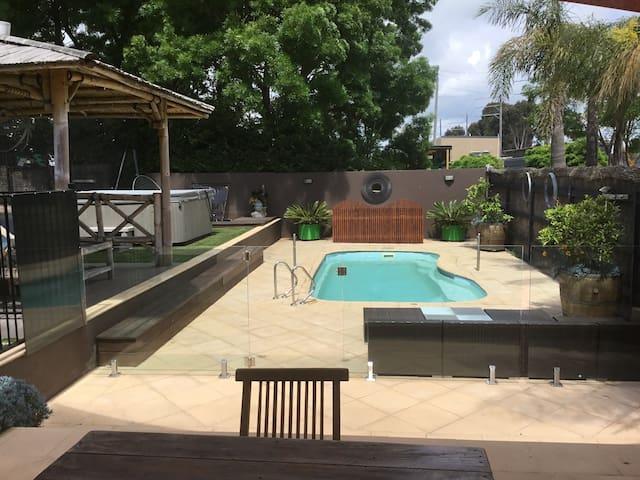 Solar heated salt chlorinated swimming pool.