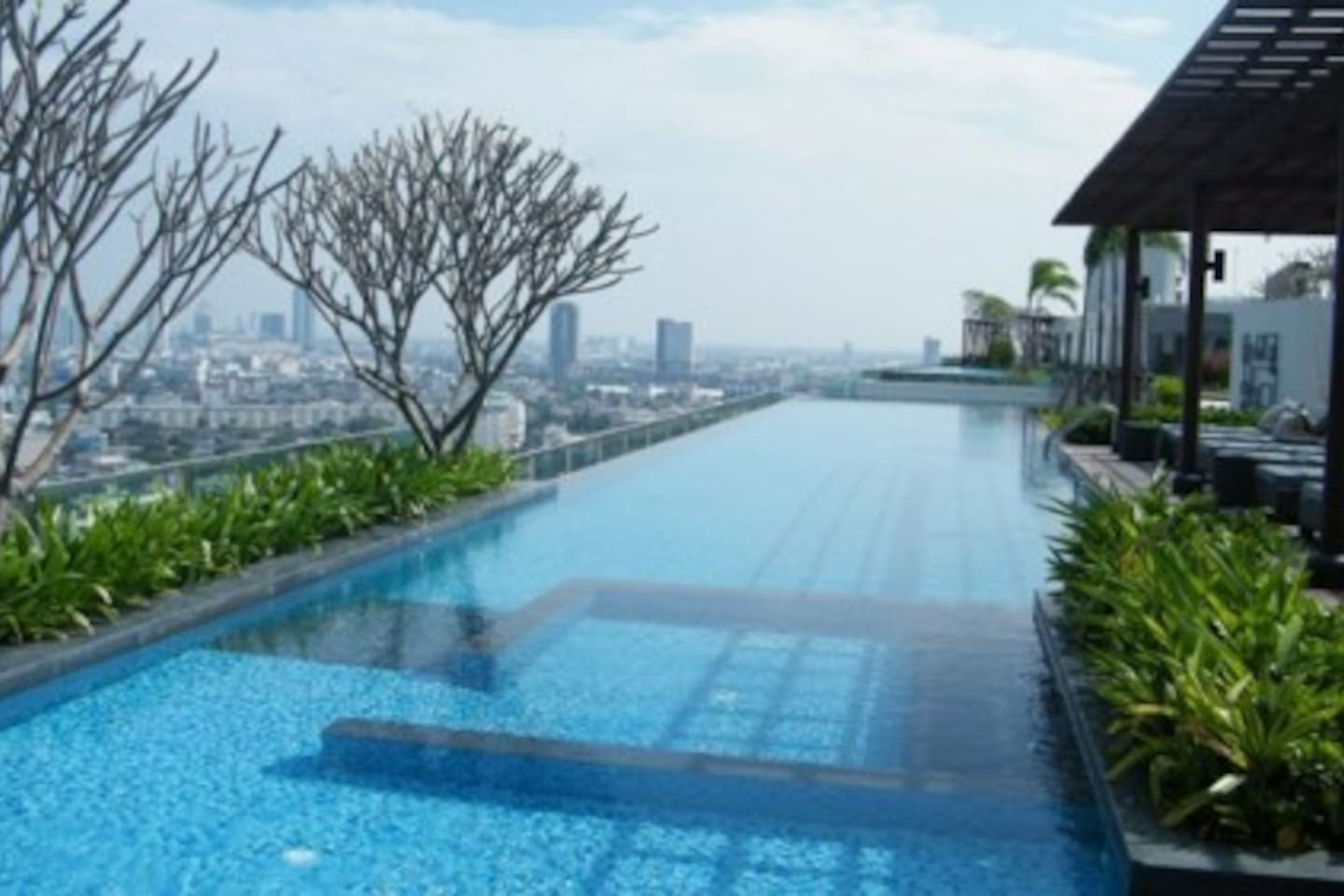 There is twin pool at the rooftop of building 22nd floor with stunning view.