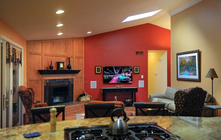 Family room with fireplace and 55-inch HDTV.
