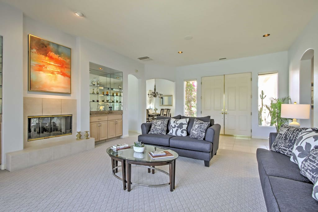Lounge in the chic formal living room, complete with a wet bar.