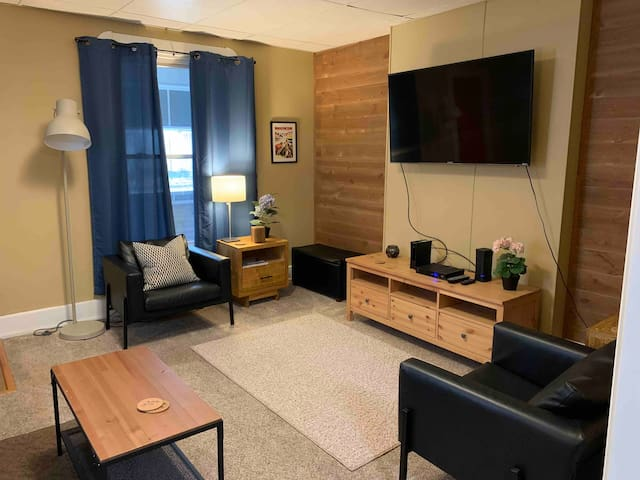 Living room with 55 inch smart TV.