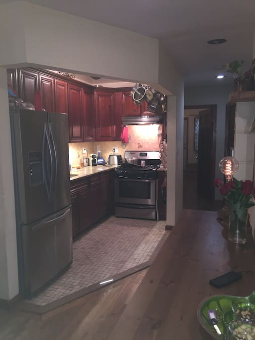 Kitchen with All clad pots, ice maker, gas stove