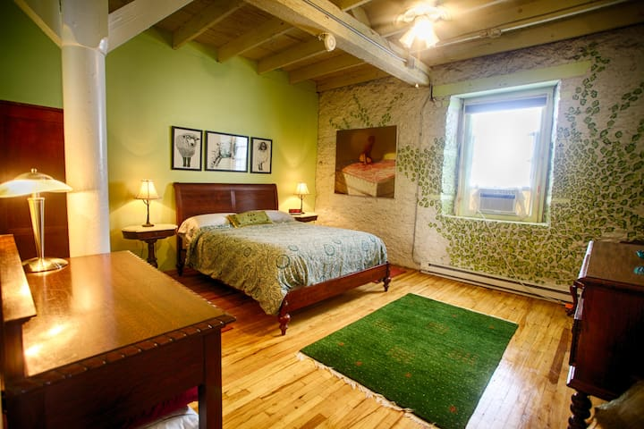 Comfortable queen-sized bed, large bedroom
